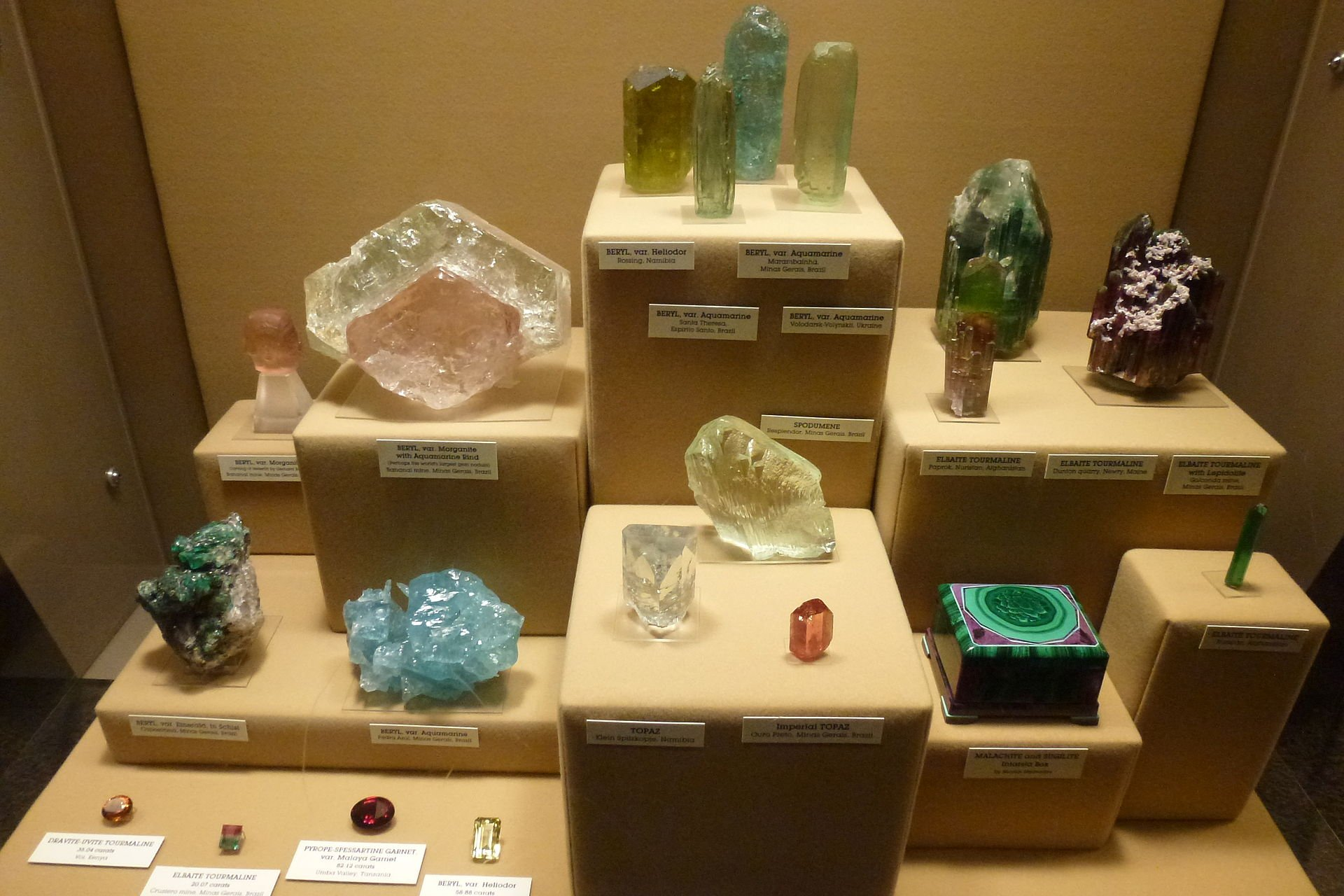Many minerals, gems, and other rock specimens are on display.
