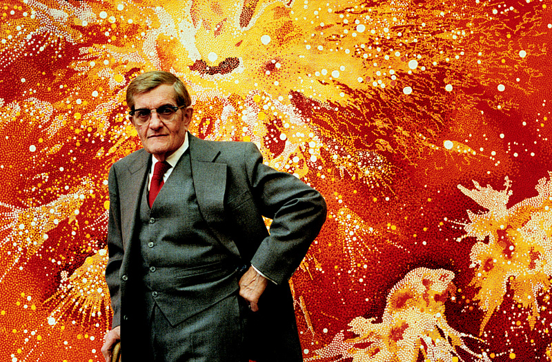 Vance Kirkland with his 1978 painting, Explosions of Energy Near the Sun Fifty Billion Years B.C. (image from the Kirkland Museum)