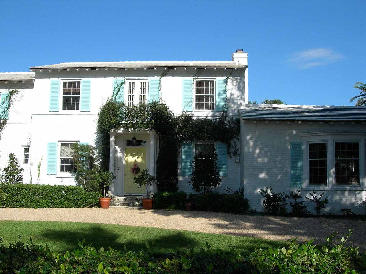 Built in 1937, the Cocoanut Road House is a fine example of Colonial Revival architecture.