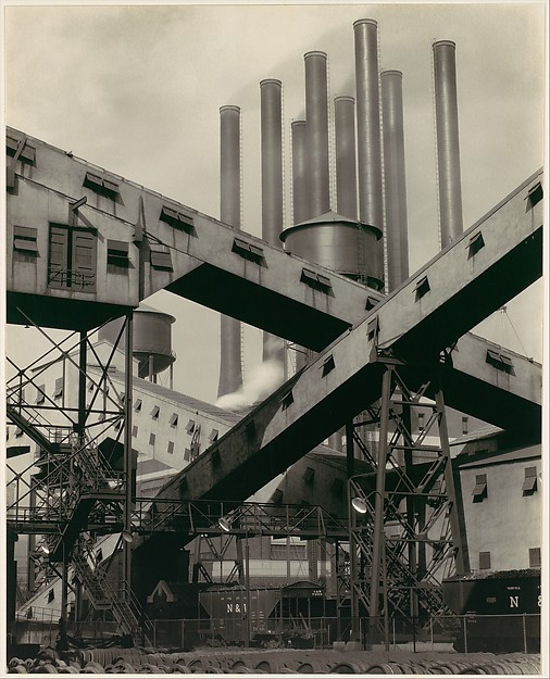 An iconic photo by Charles Sheeler of conveyors at the plant