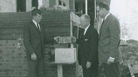 The cornerstone is laid during the construction of the library, 1964