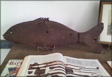 This original fish weathervane that is believed to have been shot by the notorious Jesse James Gang in 1868.