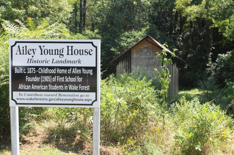The new sign that shares the information with the community about the historical site (5). 
