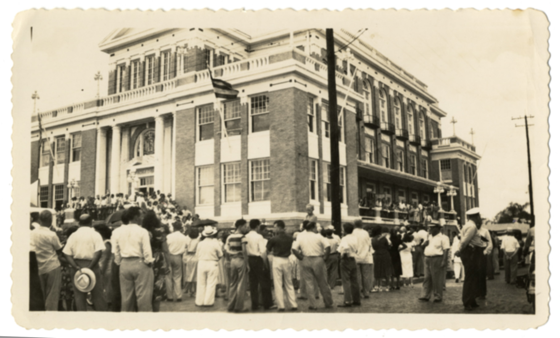 Crowds gather outside of the Club in this 1940s photo