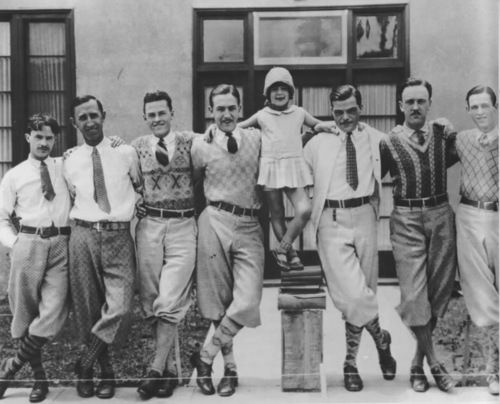 Laugh-O-Gram Studio animators. Child actress Virginia Davis stand in the center.