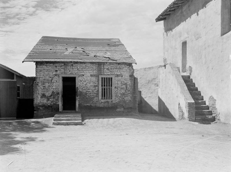 The quarters of the Mission's friars in 1938, partway through the Mission's complete restoration (LA Public Library).