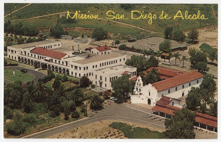 A 1960 postcard reveals an aerial view of the Mission, fully restored two decades earlier