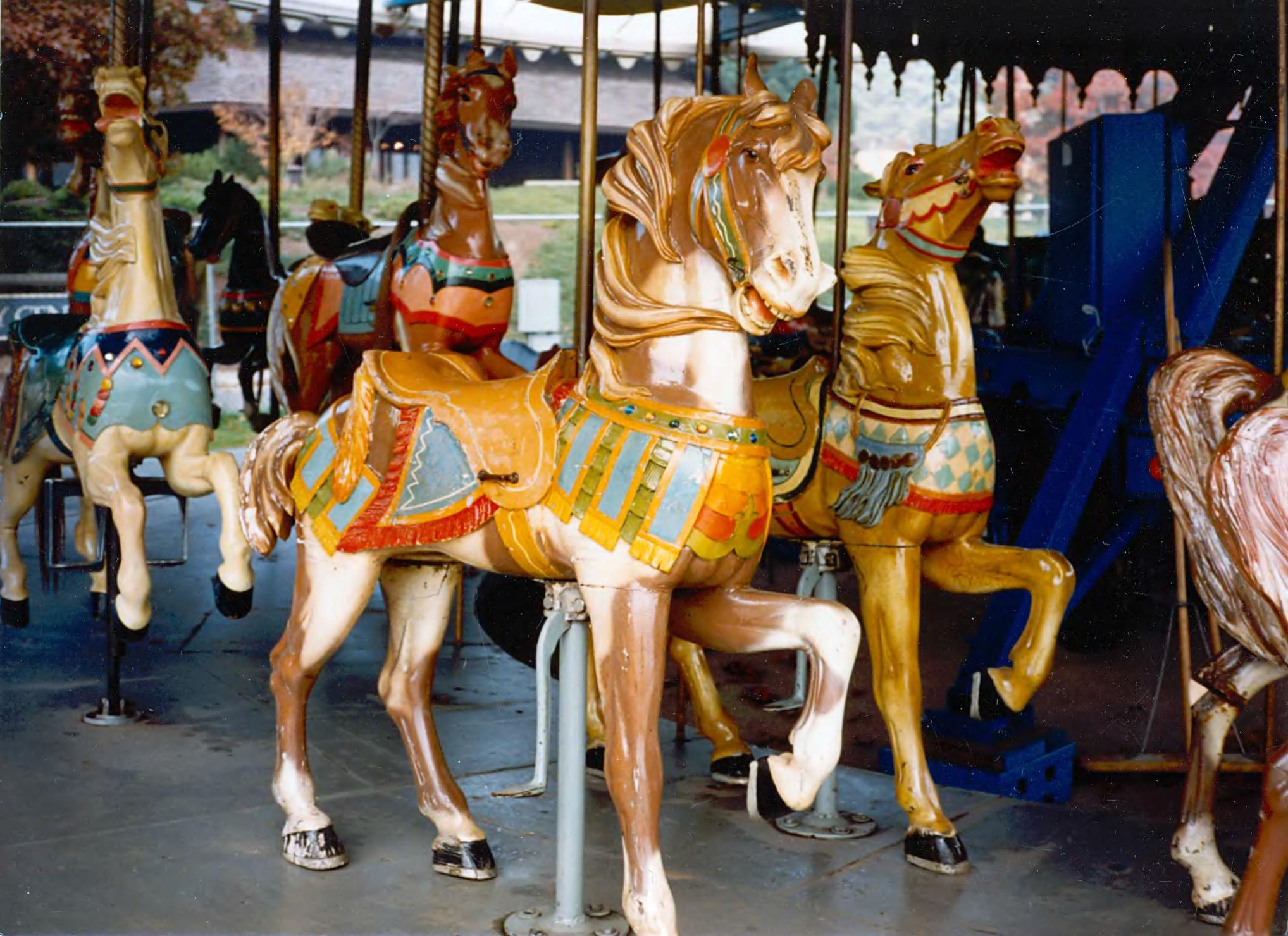 Detail of the carousel horses (Wikimedia Commons)