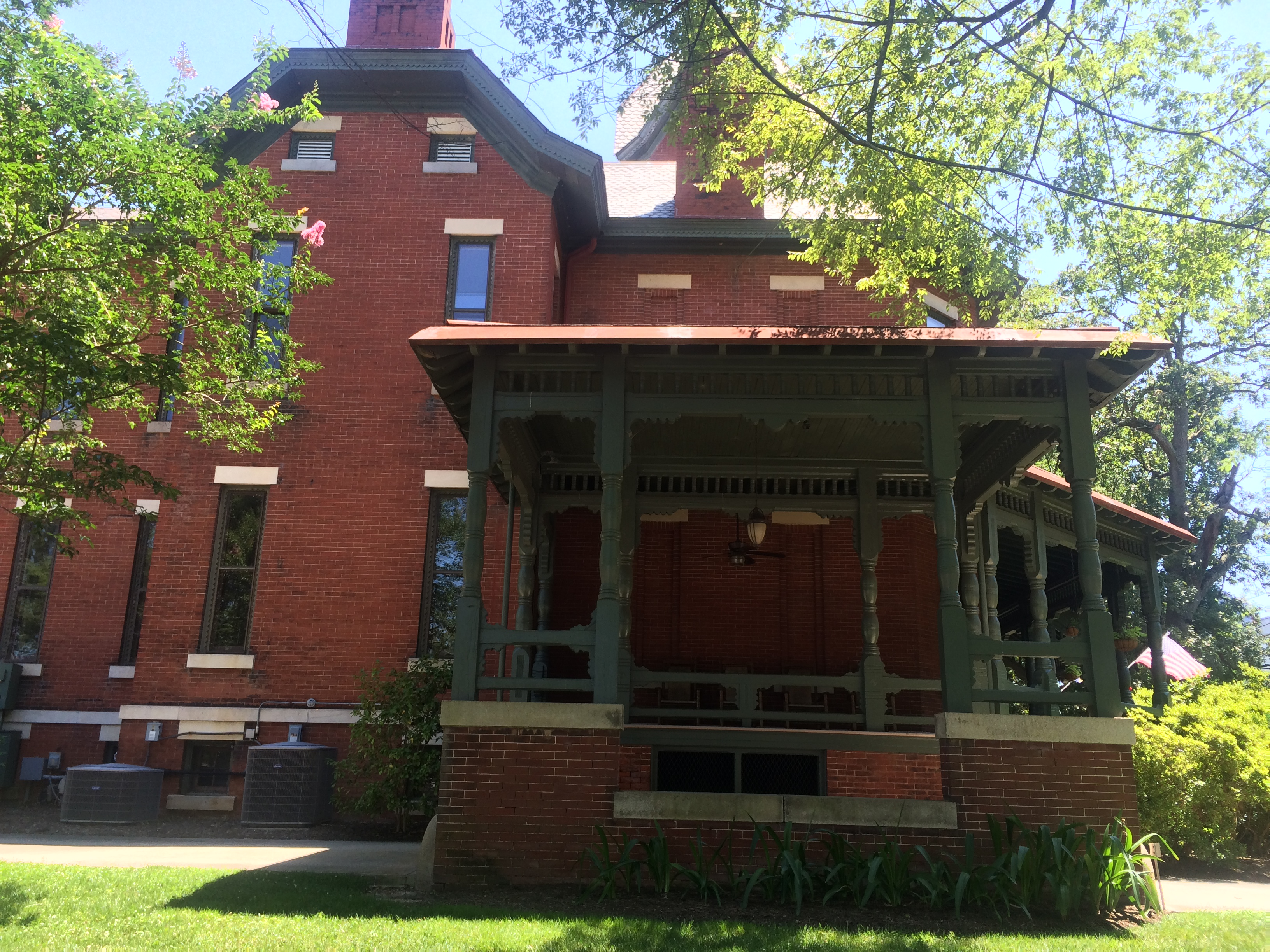 A view of the northern facade, taken facing south. This perspective emphasizes the iconic large verandah.