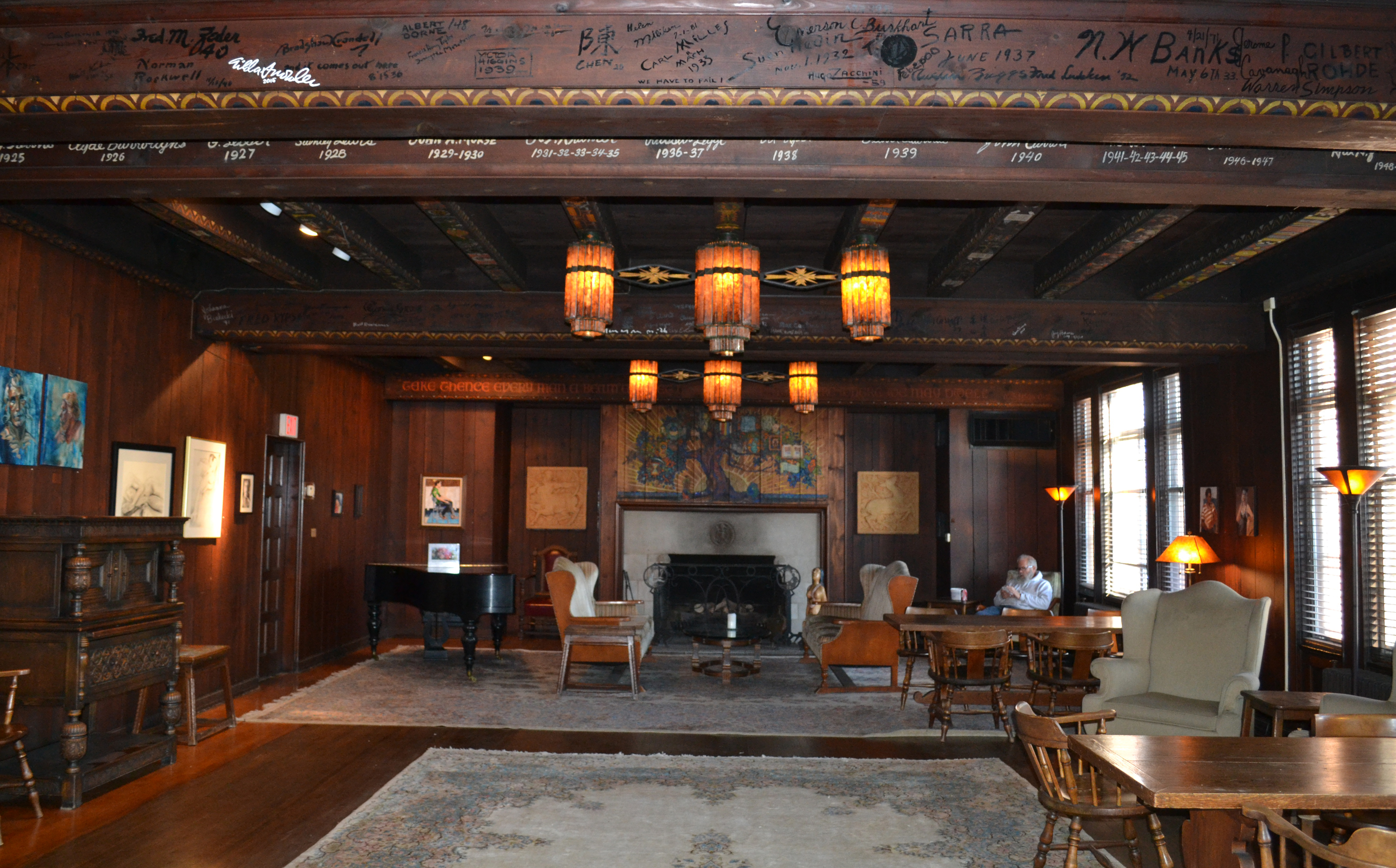 Inside the clubhouse lounge, showing the signatures of famous artists on the ceiling beams.