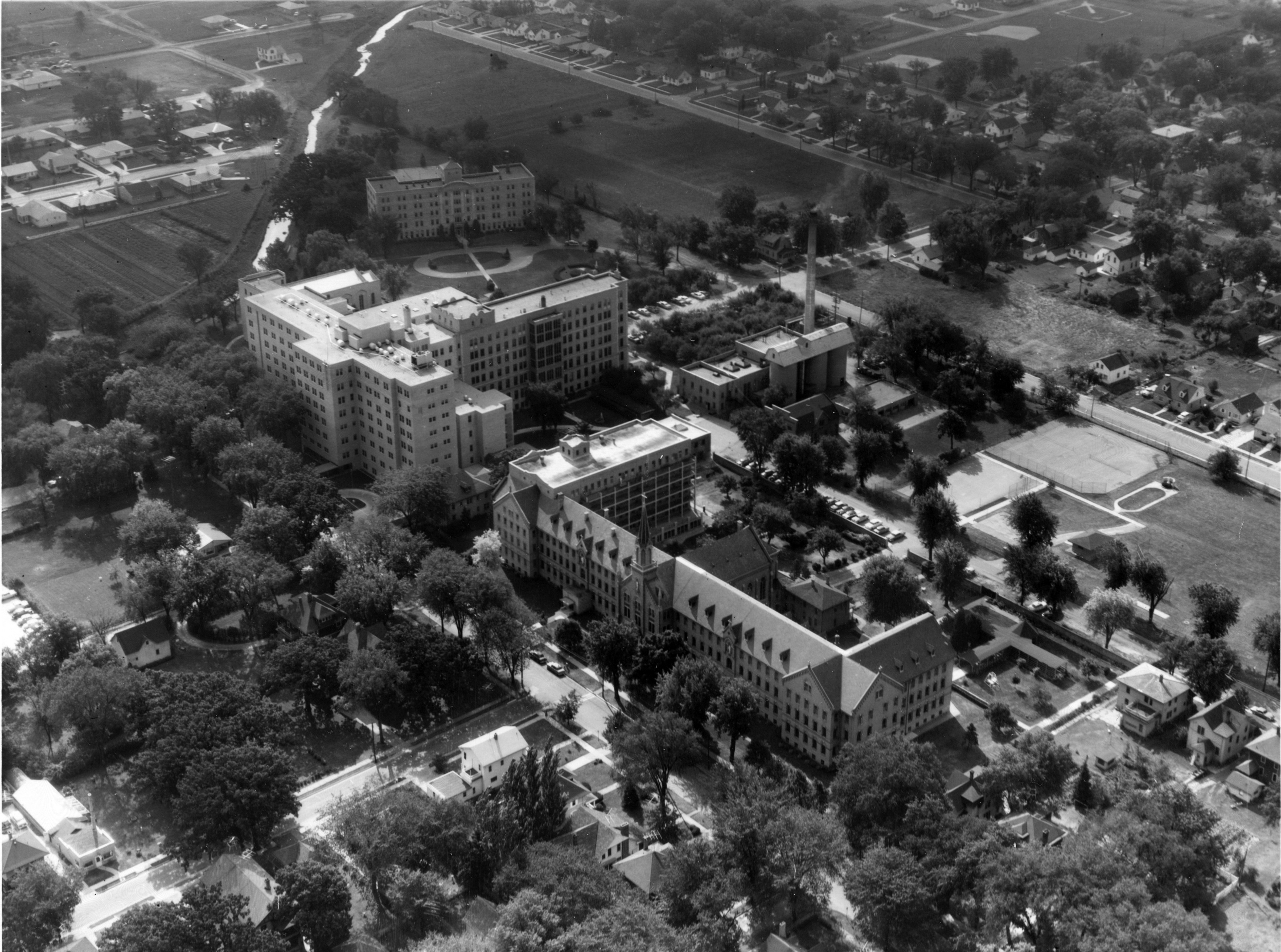 Aerial view of St. Agnes Hospital with convent in the foreground and St. Agnes School of Nursing in the background, 1957