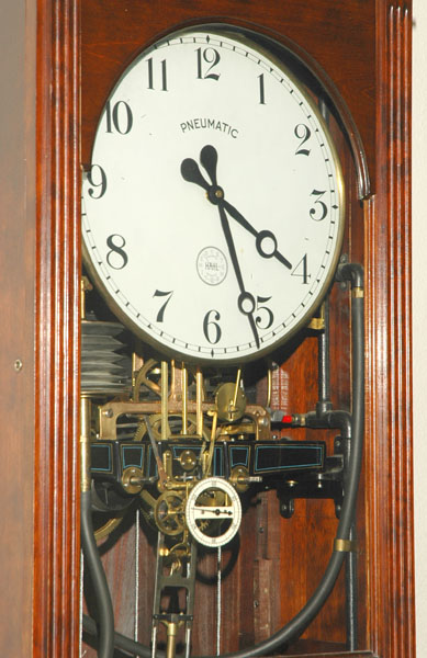 A close view of one of the building's pneumatic clocks