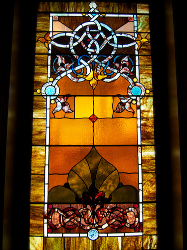 Stained glass window in the Arts and Crafs style. Photo by beautifulcataya licensed under Creative Commons: https://creativecommons.org/licenses/by-nc-nd/2.0/legalcode