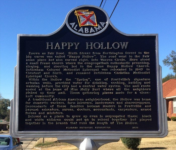 This historical marker describes Happy Hollow's history.