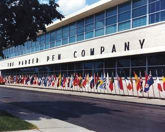 The front of the building, featuring the company's extensive collection of national flags.
