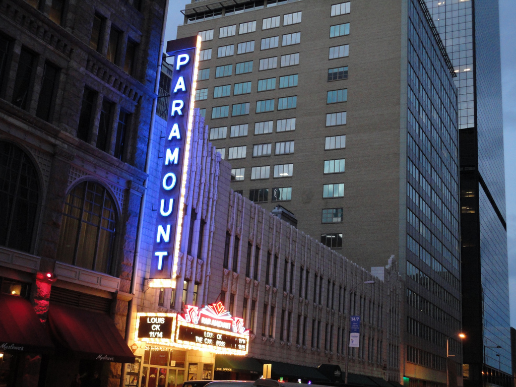 The Paramount Theatre's neon sign at nightfall. Photo by Paul Sableman. Licensed under Creative Commons.