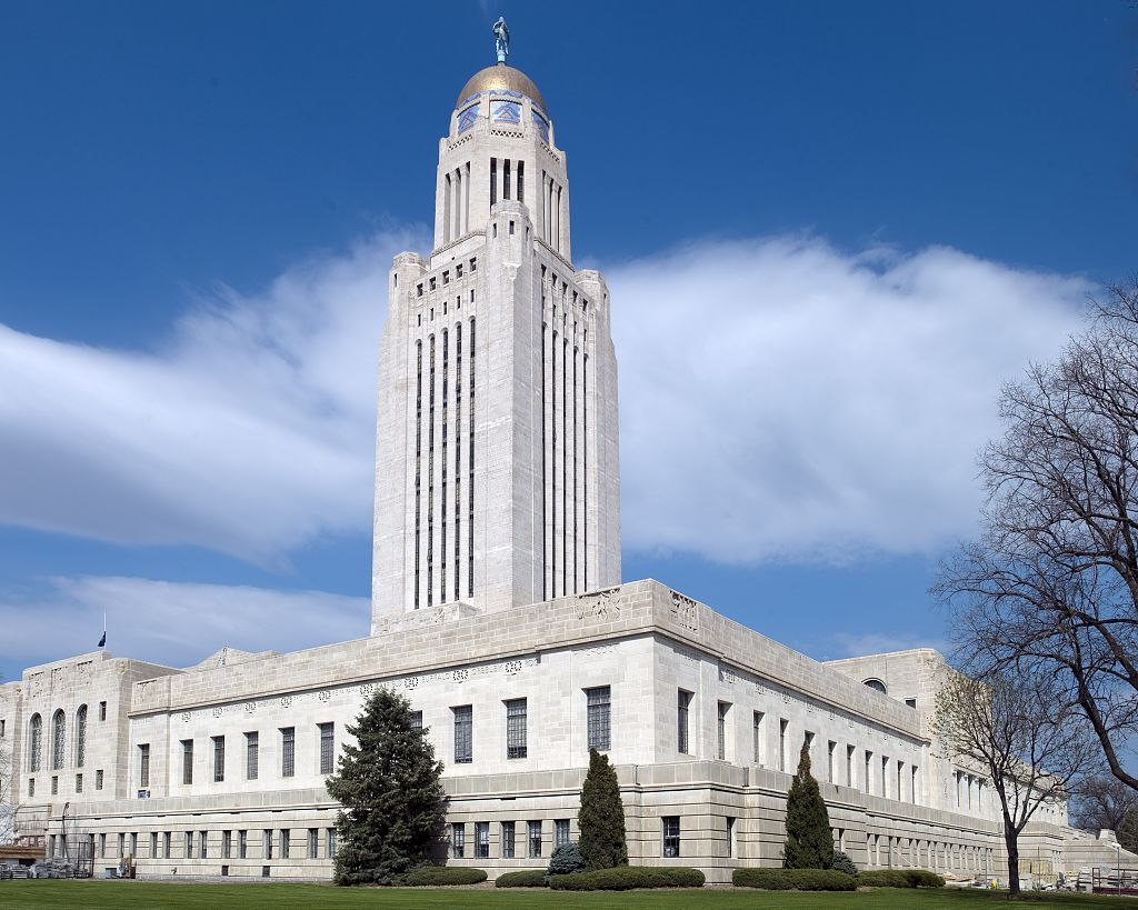 "The Nebraska State Capitol was built in 1932 after ten years of construction. The tower rises to a height of 400 feet and is topped with a large statue called ""The Sower."""