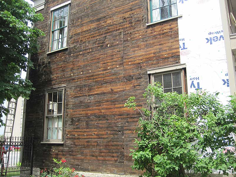 Old wooden siding exposed during renovation
