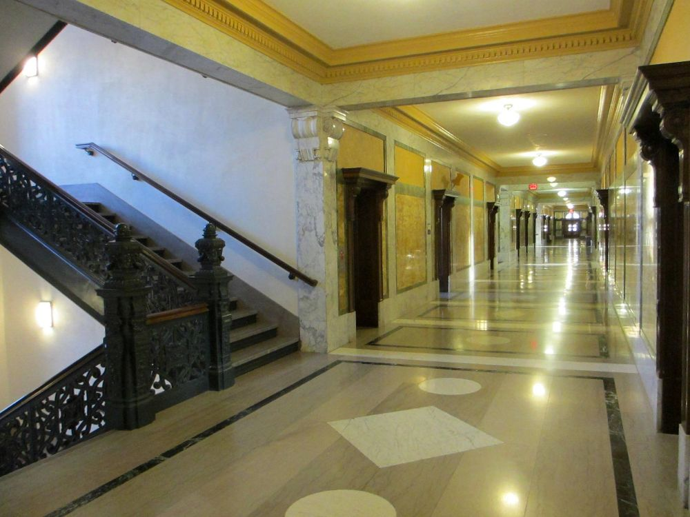 The main corridor has marble walls and oak woodwork