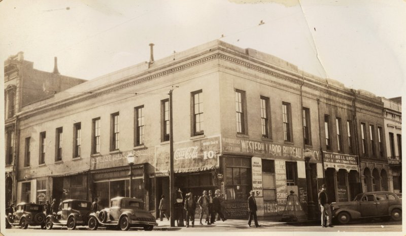 In 1936, the building appears to have duplicated its 1850s setup--with private business below and government functions on the second floor. (California State Library).