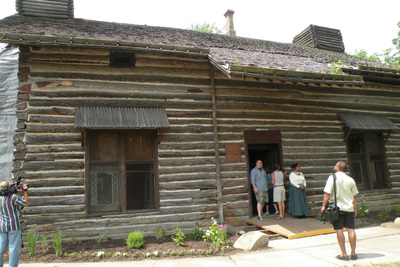 "Visitors come to see inside when the cabin is open on ""Log Cabin Days"""