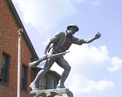 With his arms stretched forward and the gun at his side, the statue depicts the American infantryman as a heroic figure.
