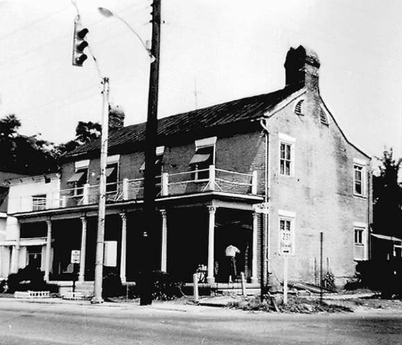 A view of the home in 1962 shows the house in a state of disrepair. The porch was removed but the rest of the structure was preserved.