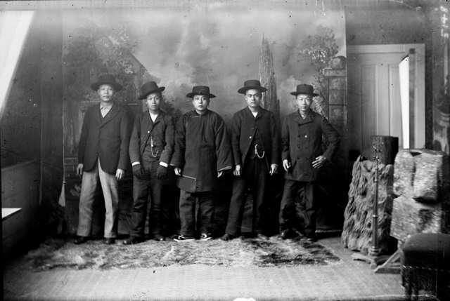 Chinese-American men pose in a photographer's studio in Georgetown, Colorado. The growth of Colorado's cities, railroads, and mines drew hundreds of Chinese workers into the state.