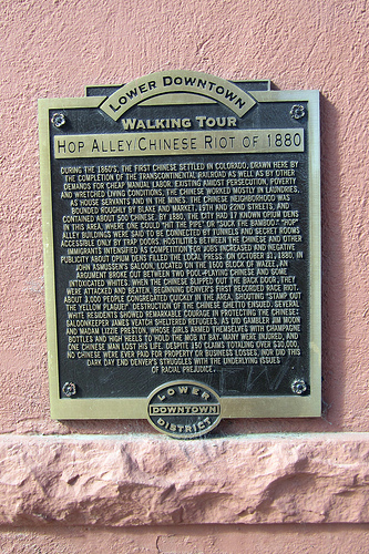 A historic plaque near the intersection of Blake and 20th Streets, commemorating the Chinese presence in Lower Downtown Denver and the anti-Chinese riot of 1880. Photo by Wally Gobetz. Licensed under Creative Commons.