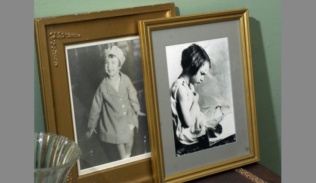 Mary Flannery at ages 3 and 4 years old, respectively. These photographs sit on one of the mantles.