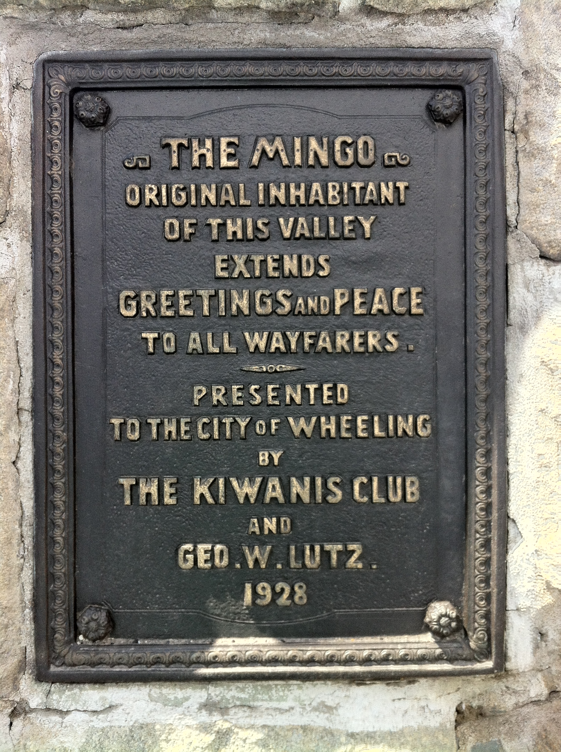 The plaque on the base of the Mingo Statue
