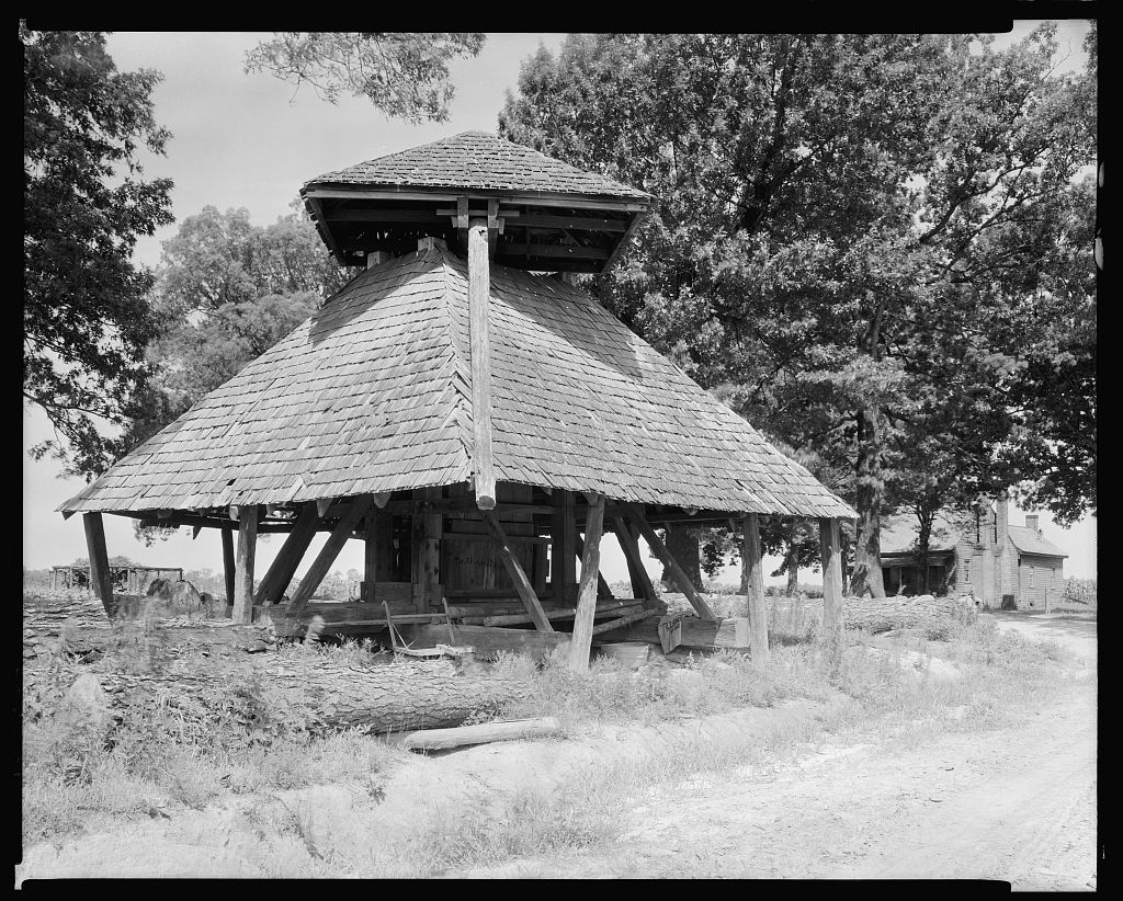 Norfleet Cotton Press in its original location on the Norfleet Farm on West Wilson St. Photo from Library of Congress Francis B. Johnston collection taken in 1936.