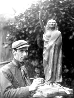 Sculptor James Wehn with a model of the Chief Seattle statue in 1908 (image from History Link Encyclopedia)