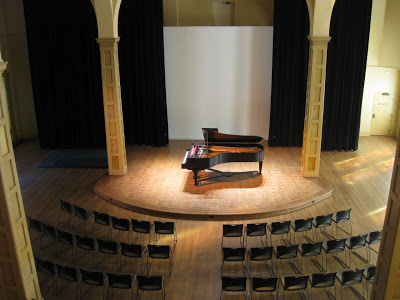 Stage and piano in the performance space (image from Chapelspace Blog)