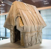 Photo by DJ Ashton, courtesy of the Charles M. Schulz Museum and Research Center. Christo Wrapped Dog House