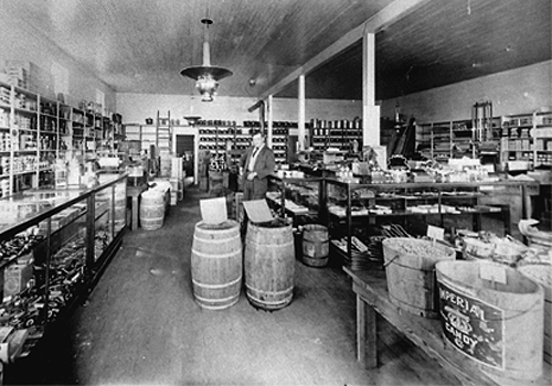 Irving Kimball in the store, 1915