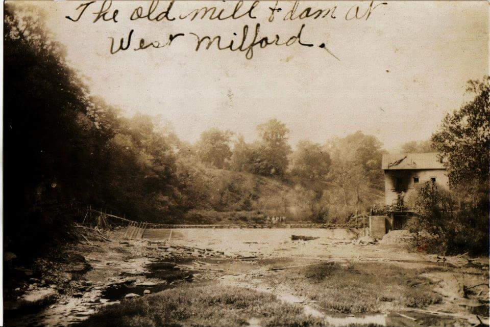This photo shows the old grist mill dam being modified to its current state sometime around 1920 Notice in the fire damage on the upper left-hand side of the mill.