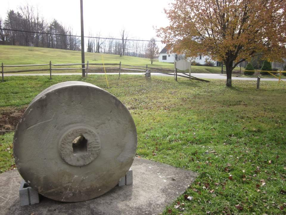 One of two remaining millstones saved by Scotland Highland, This stone is located at the city building in West Milford, W.V.