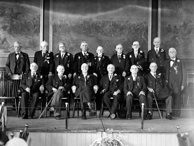 GAR members in 1932 in the auditorium. Notice the murals on the wall depicting Civil War battles.