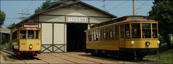 Two of the museum's streetcars sit outside the shed at the Excelsior stop.