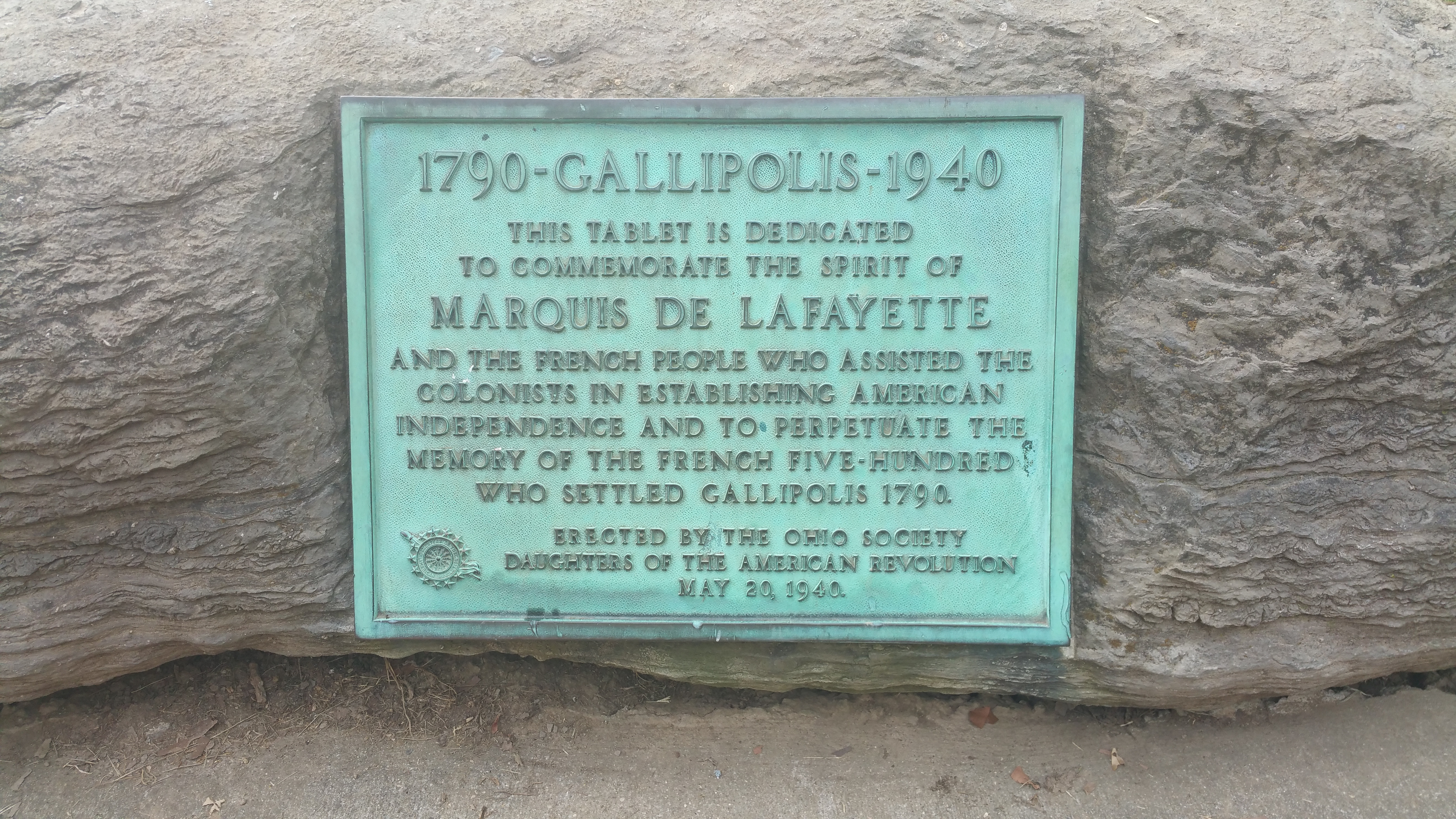"""This tablet is dedicated to commemorate the spirit of Marquis de Lafayette and the French people who assisted the colonists in establishing American independence and to perpetuate the memory of the French Five-Hundred who settled Gallipolis."""