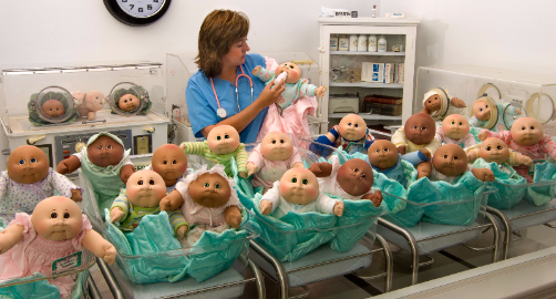This is a picture of a 'nurse' taking good care of the Cabbage Patch babies.