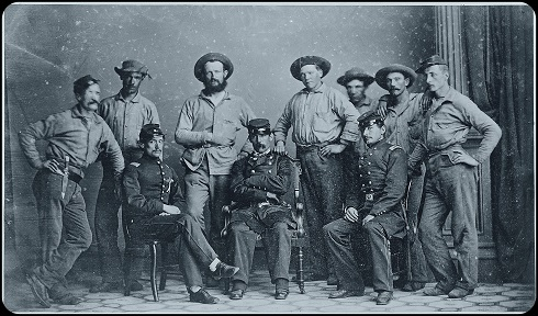 Colonel William (Billy) Wilson, seated center, of the 6th Regiment of New York Volunteers Zouaves and some of men taken sometime after the battle