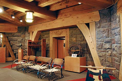 Large wood beams are the building's main structural elements.
