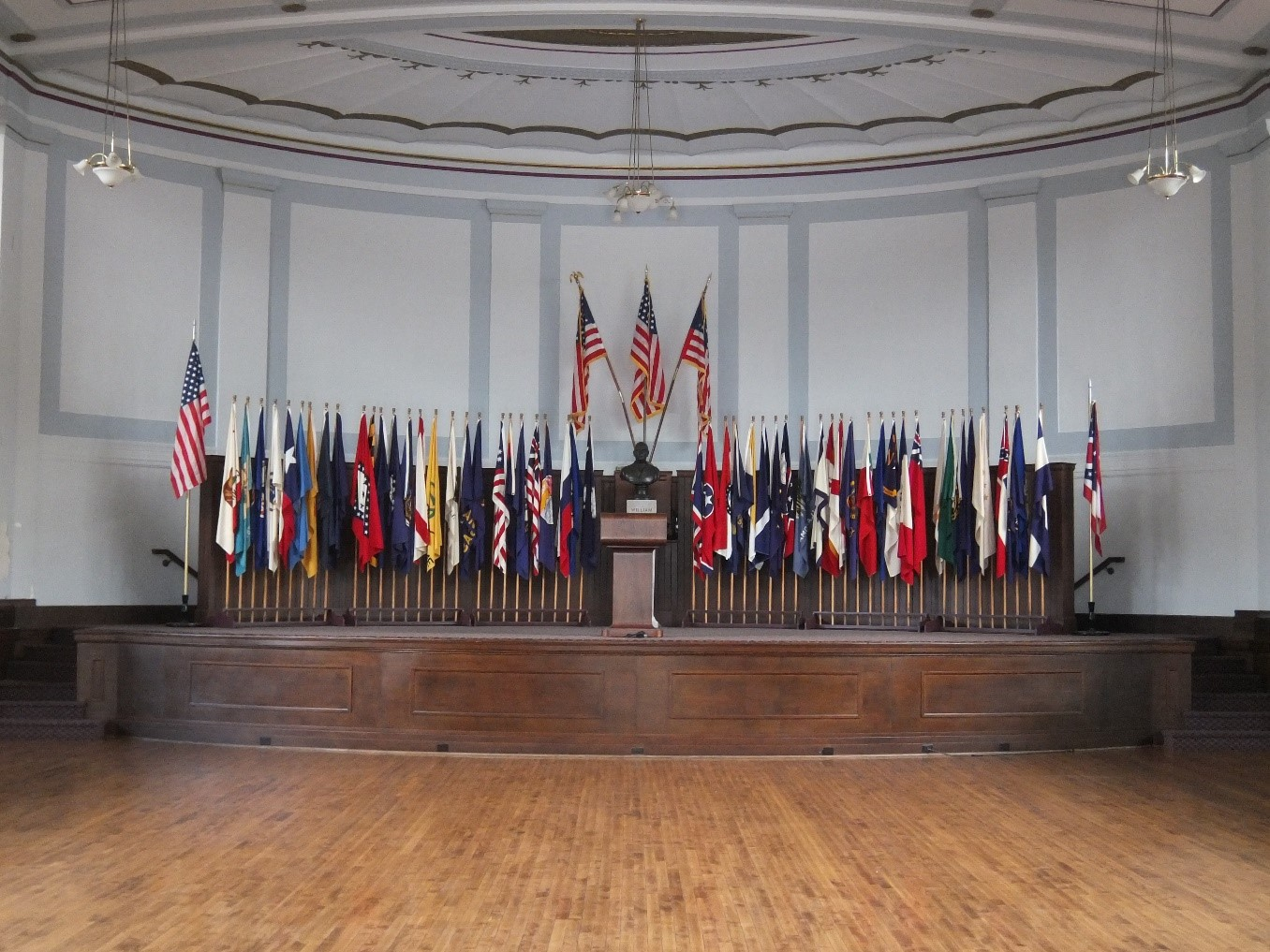 The auditorium stage features fifty state and four territorial flags, and a bust of William McKinley