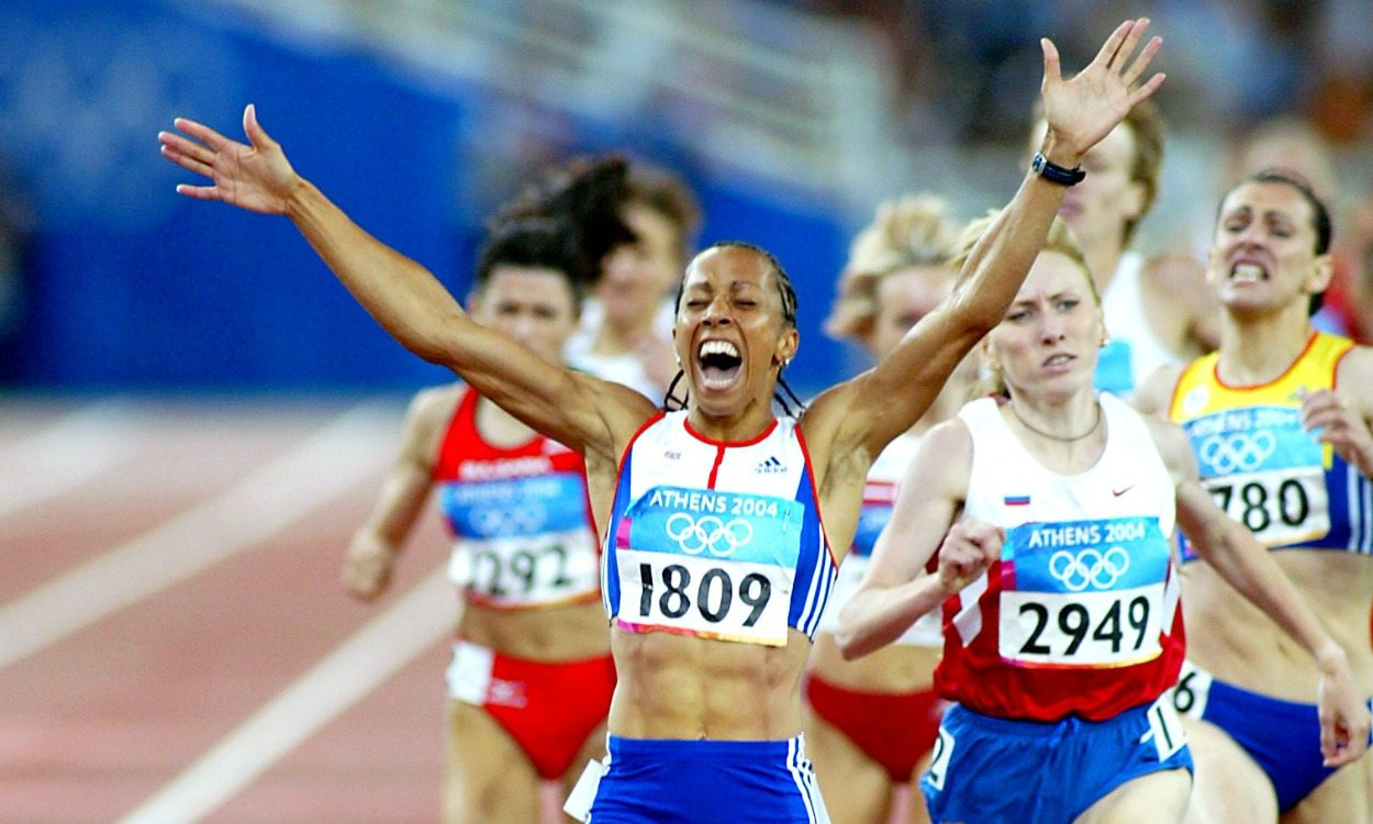 Kelly Holmes celebrating after achieving victory