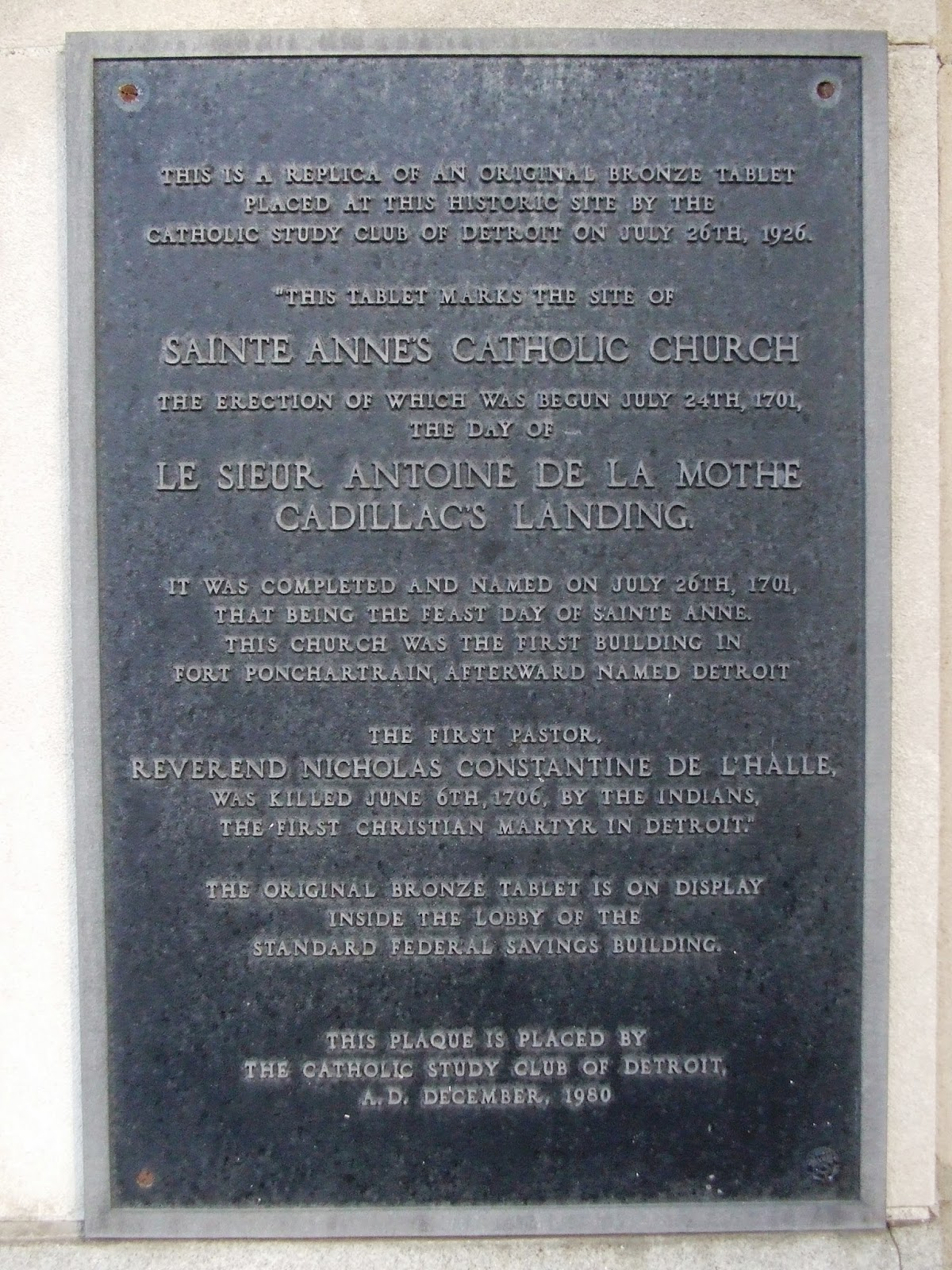 A plaque on the corner of Griswold and Jefferson indicates the location of the first Ste. Anne's