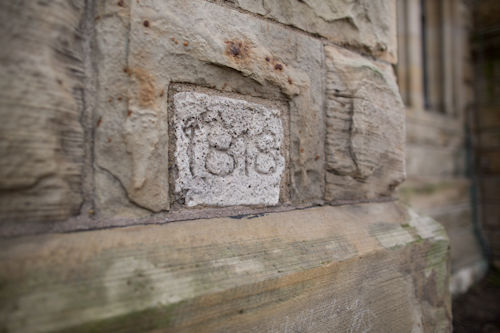 The cornerstone of the church built in 1818, at the current Ste. Anne's