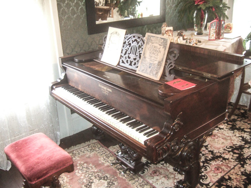 The 1877 Steinway is in the restored music studio in the home