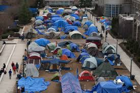 "It has become tradition before each home game against rival North Carolina for the Crazies to camp out in ""K-Ville."" This process usually starts months before the game and requires students to be first in line in order to receive the best seats. However, all home games reach standing room only in the student section."